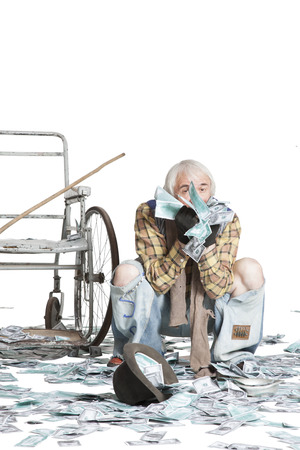 A huge pile of dollars fell from the sky to a beggar in a wheelchair