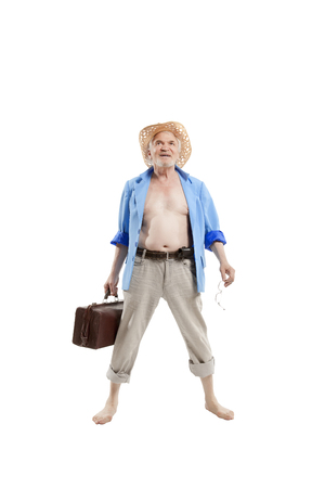 Elderly man posing in the studio on a white background depicting a vacationer arriving at the beach Banco de Imagens
