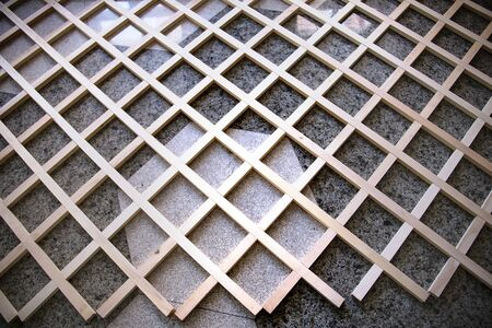 Background from a wooden grate lying on a tiled concrete floor 写真素材 - 134419182