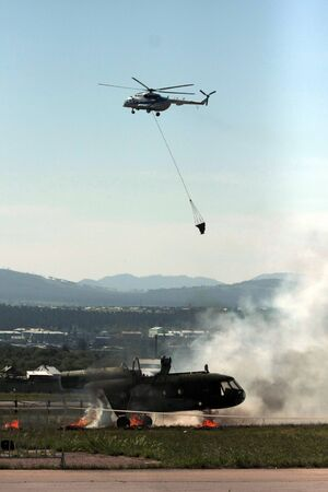 The helicopter exploded, fell to the ground and burned. Rescue exercises in a plane crash.