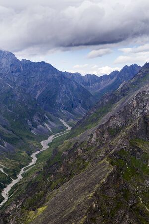 View of the mountains of the Tunkinsky National Park in the Republic of Buryatia of the Russian Federation from the cockpit of the helicopter. The name of the mountain range -  Eastern Sayans.