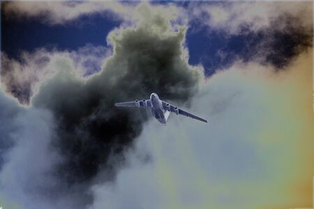 A multi-purpose four-engine turbofan strategic airliner flies high in the sky against a background of clouds 写真素材 - 134419084