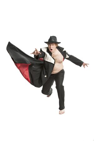 A man poses, jumps, flies in a suit in the steampunk style in the studio on a white background