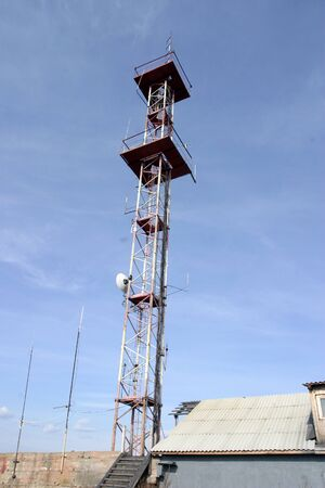 Tower of radio, telecommunications, cellular telephony on a background of blue sky