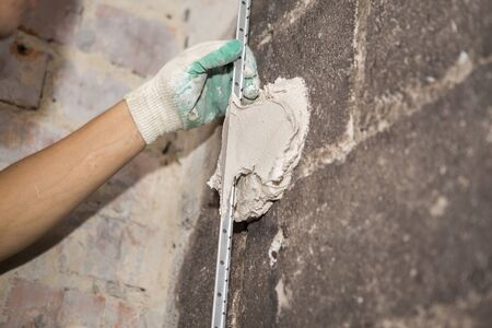 Repair of premises after a fire. Manual wall preparation and plastering