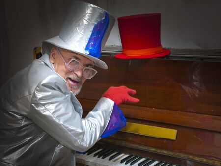 Magician in a suit playing the piano