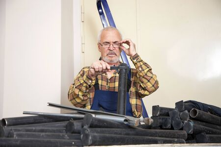 Engineer measures with tool the size of the pipe in the room