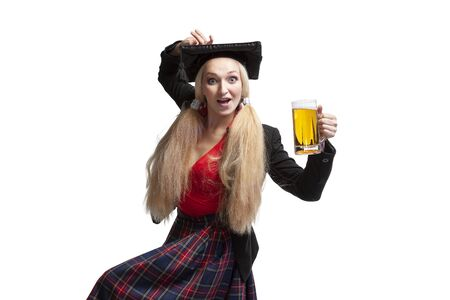 Female student in traditional graduate costume dancing holding a beer mug