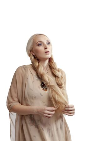 Beautiful blonde with long braids sings a song while looking to the sky