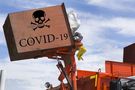 Coronovirus-infected garbage is transported by a garbage truck to a landfill for disposal. COVID-19.