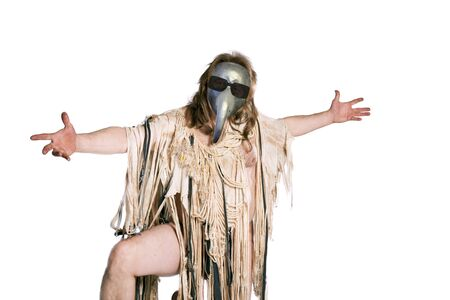 Half-naked man with long hair in medieval rags and a plague mask on a white background
