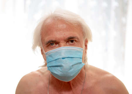 Lonely elderly man, at the onset of covid disease. First stage