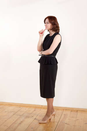 Photo session during the dialogue of an intellectual business woman in a black business suit with a business partner on a white background