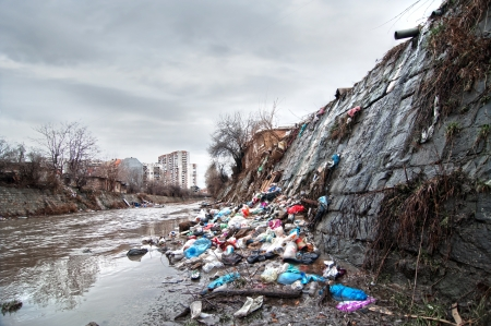 Illegal landfill near city sewer Stock Photo