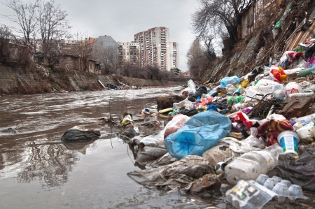 garbage dump: Illegal landfill near city sewer Stock Photo