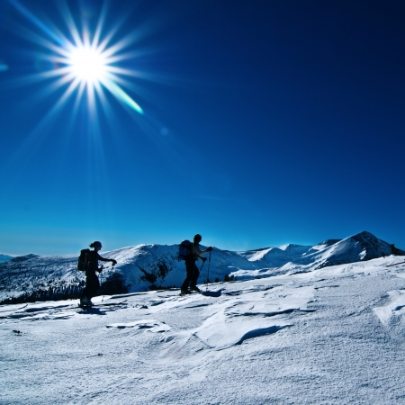 Blue sky with sun, mountain background Stock Photo