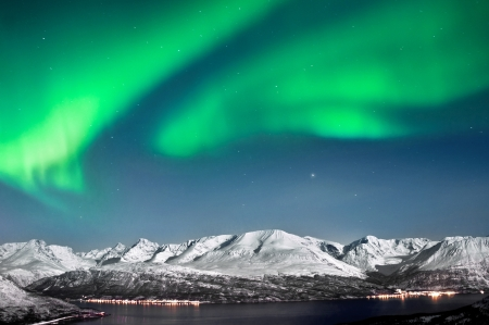 Beautyful Aurora above fjords near Skibotn, Norway