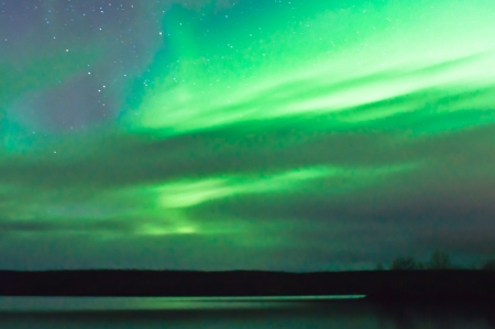 Aurora over lake in Norway near Kautokeino photo