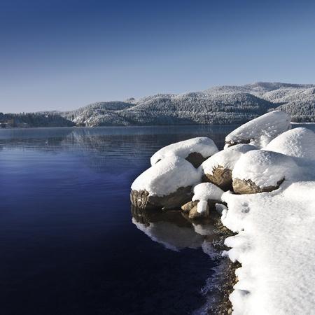 Winter lake II  Snowcapped rocks foreground, blue sky, 1x1 crop