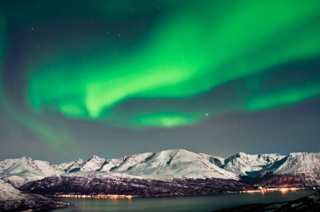 Aurora above fjords near Skibotn, Norway photo