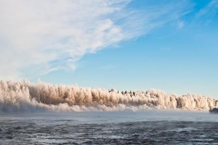 scandinavian landscape: Beautyful cloudy sky above river and forest