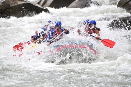 White water Rafting as extreme and fun sport Imagens