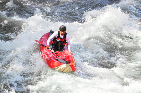 White water kayaking as etreme and fun sport photo