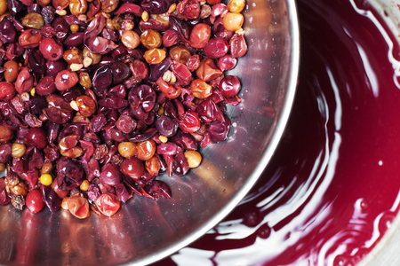 percolate: Making red wine. Percolating red wine.