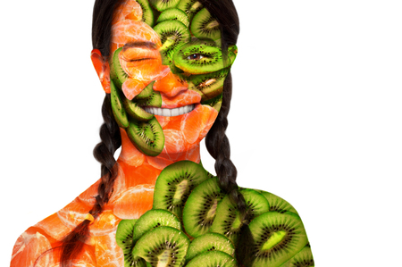 Portrait of a woman with kiwi and orange skin. photo