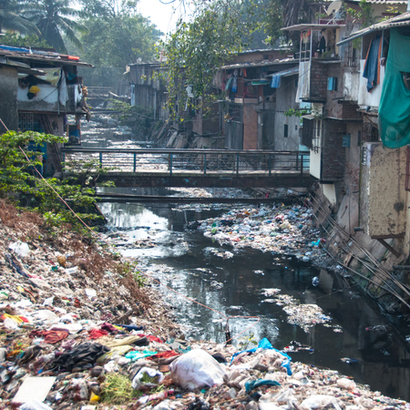 Illegal landfill in an asian city Stock Photo