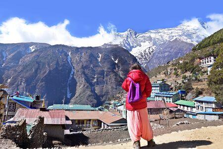 sherpa: Trekker looking at Namche Bazaar, Himalaya, Nepal