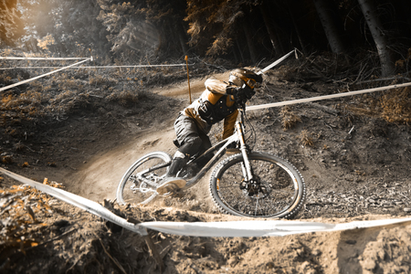 extreme sports: Sport race Mountain biker extreme and fun downhill track. Jumps and dirt splashes.