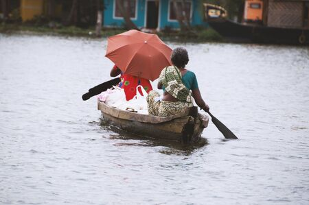 Asian people travel by a boat
