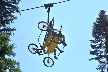 Bikers on a mountain lift. Stock Photo