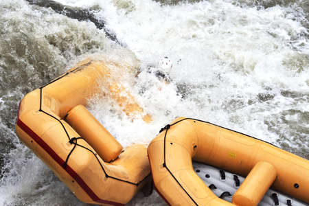 Rafting, boats stuck in a rapid. Whitewater rafting. Standard-Bild