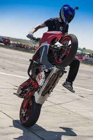 stunt: Vinnytsia,Ukraine-July 25, 2015: Unknown stunt biker entertain the audience before the start of the championship of drifting   on July 25,2015 in Vinnytsia, Ukraine.