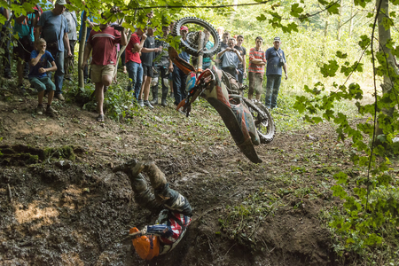 Lviv, Ukraine - 11 Septemberl 2016: The third stage of the Ukrainian championship in cross-country cycling . Unknown rider falls at overcoming the track in the woods Editorial