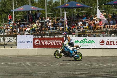 Lviv, Ukraine - June 7, 2015: Unknown stunt biker entertain the audience before the start of the championship of Ukraine drifting in Lviv.