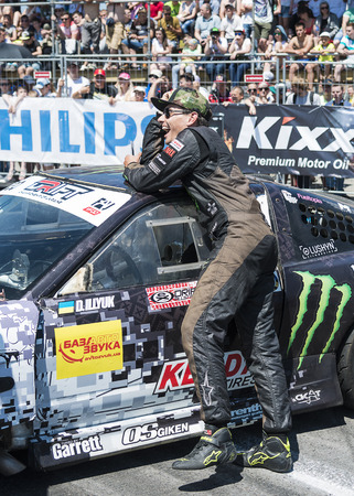Lviv, Ukraine - June 7, 2015: Rider Dmytro ILLYUK near his car brand Nissan before the championship of Ukraine drifting in Lviv, Ukraine