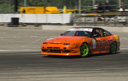 Lviv, Ukraine - Juny 6, 2015: Unknown rider on the car brand Nissan overcomes the track in the championship of Ukraine drifting in Lviv.
