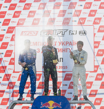Lviv, Ukraine - June 7, 2015:  Awarding ceremony of the first stage of the Ukrainian championship Drift, 1st Dmytro ILLYUK , 2nd Alexey Golovnya, 3rd Volodymyr Borovitski near Arena - Lviv stadium.