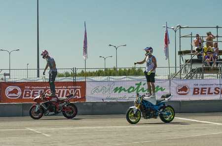 Lviv, Ukraine - June 7, 2015: Unknown stunt bikers entertain the audience before the start of the championship of Ukraine drifting in Lviv.