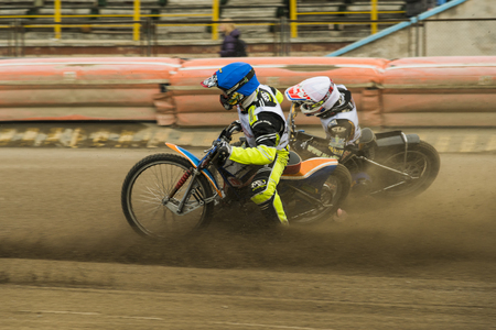 sidecar motocross racing: Rivne, Ukraine - 11 Oktober 2015: Two unknown riders overcomes the track at the Open Cup Speedway to the day of the city Rivne