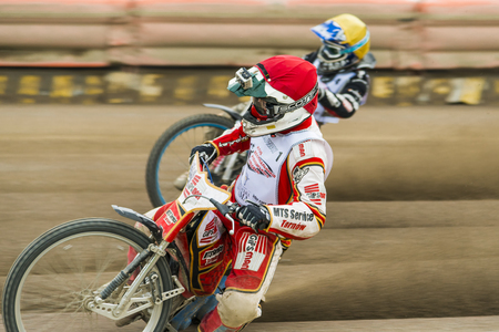 Rivne, Ukraine - 11 Oktober 2015: Unknown rider with GoPro camera overcomes the track at the Open Cup Speedway to the day of the city Rivne