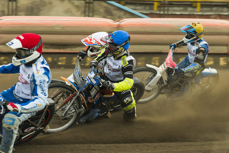 sidecar motocross racing: Rivne, Ukraine - 11 Oktober 2015: Four unknown riders overcomes the track at the Open Cup Speedway to the day of the city Rivne