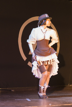 Lviv, Ukraine - May 23.2015: A girl dressed in the style of wild west performs on stage during the festival cosplay Anicon in Lviv May 23.2015