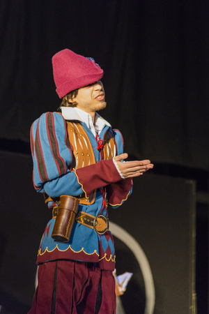 Lviv, Ukraine - May 23,2015: Man  dressed in the style of the Middle Ages performs on stage at the festival cosplay Anicon in Lviv May 23.2015