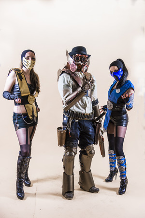 Lviv, Ukraine - May 23.2015:Cosplayer boy and girls posing in a steampunk suit and a respirator mask , Photo taken at cosplayers meeting indoor concert hall in Lviv city.May 23.2015 Editorial