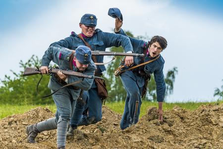 Snina, Slovakia - May 28, 2016: Military historical reconstruction battles of World War I Karpaty 19141916. Participants of the event stand on the attack near Snina, Slovakia.