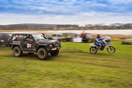 sidecar motocross racing: Lviv, Ukraine - April 18, 2015: Off-road vehicles and motorcycle during non-professional competition around Lviv.Ukraine
